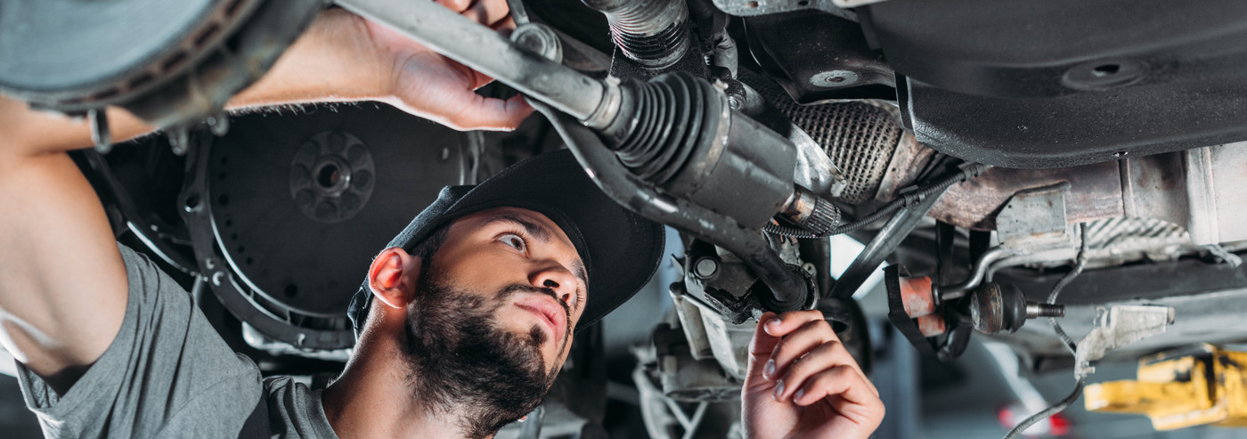 Mechanic looking underneath a vehicle - Car Repairs Ayr